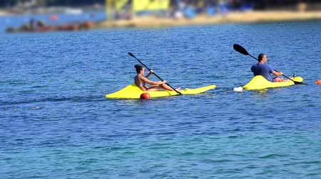 kayak : sea kayak. People having fun rowing at open sea