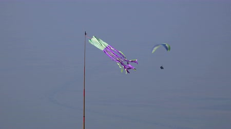 adrenalin : Paragliding, wind direction sign with paraglider at background