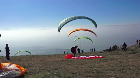 adrenalin : Paragliders take off mountain during paragliding extreme sport competition