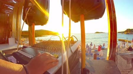 brasil : Ipanema, Brazil,  summer beach party dj at sunset on crowded summer beach at a tropical resort, crane shoot