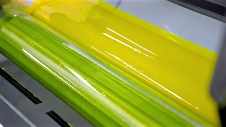 print shop : Yellow Paint Running Off a Roller in Offset Printing Press, HD LOOP