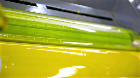 printings : Yellow Paint Running Off a Roller in Offset Printing Press, HD LOOP