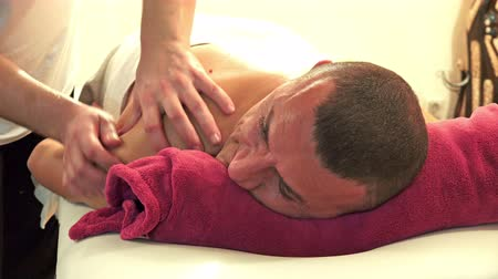 acupressure : 4K man enjoying massage therapy at a luxury health spa, UHD stock video Stock Footage