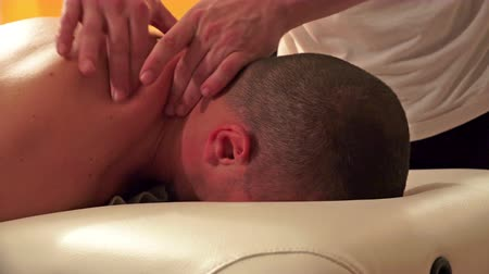 acupressure : UHD sport man having a great neck massage in beauty spa center, 4K stock video