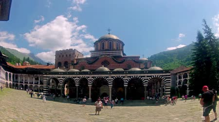 bulgaristan : RILA, BULGARIA Tourists in Church in Rila monastery before daily procession, Bulgaria, panning timelapsE Stok Video