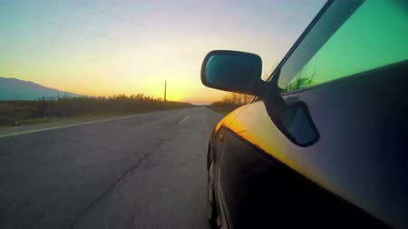 carros : 4k Angle shot of a sport car against sunset in the background. Fast race on asphalt road, uhd stock video