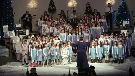 церковь : Conductor, musicians and chorus at traditional christmas new year concert