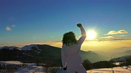 quad hd : 4K Victory Pose by Woman on Top of Mountain Sunset Lifting Hands at the Sun. Victory, Success, Business Background Concept. UHD steadycam stock video Stock Footage