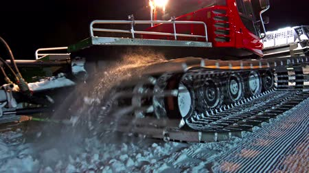 snowcat : 4K Snowcat on a Ski Resort skislope at night. UHD steadycam stock video Stock Footage
