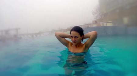 hot tub : Attractive female at spa thermal pool, slow motion stock video