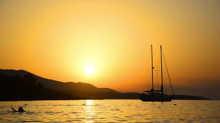 napos : Tropical sunset with ship, HD stock video, sailing boat in the sun set