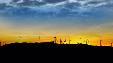 quad hd : 4K Panning Timelapse loop of wind turbines on a mountainside sunset, UHD stock video