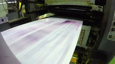 basın : 4K print plant factory, magazine line  press rollers into printing units, UHD stock video LOOP