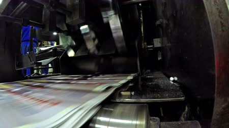 printings : 4K production lines crossing in newspaper printing press. UHD stck video LOOP Stock Footage