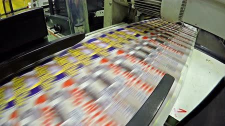printings : 4K Magazine printing in a factory, production line. UHD stock video