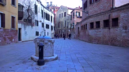 quad hd : 4K pov of vintage style old well on Venice small square. UHD steadycam stock video