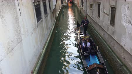 quad hd : 4k romantic couple enjoy gondola ride in Venice. UHD steadycam stock video