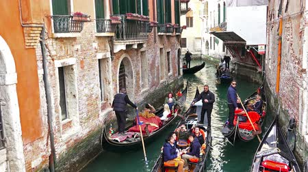 quad hd : 4K gondola traffic jam at narrow chanel. Gondola is Venice world famous attraction. UHD stock video Stock Footage