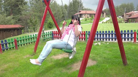 quad hd : Young beautiful woman is having fun on a swing. UHD 4K  stock footage Stock Footage