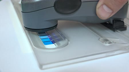 icc : 4K Print Spectrophotometer on Chart color control measurement closeup. UHD stock footage