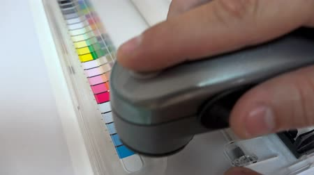 icc : 4K Print Spectrophotometer on Chart color control measurement. UHD stock footage