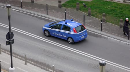 syrena : Aerial shot of emergency Police Car patrol on Venice streets. 4K UHD stock footage