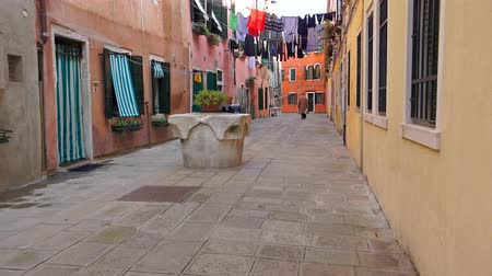 uliczka : Street alley of the rainy streets with hanging laundry in Venice, Italy. UHD 4K STEADYCAM stock footage