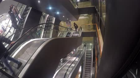 quad hd : 4k escalators at the modern shopping mall. UHD stock footage