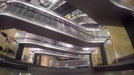 quad hd : 4k escalators at the modern shopping mall. UHD dolly shot stock footage
