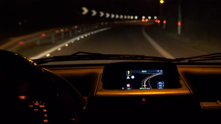 drive : Car driving at night with illuminated dashboard and navigation, POV UHD 4K stock footage