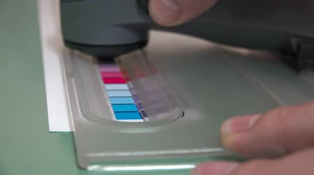 icc : 4K Print Spectrophotometer on Chart, creation of color profile, closeup. UHD stock footage