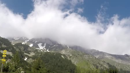 hegytömb : Time lapse of clouds roiling and flowing over peak Vihren on Pirin Mountain. A famous climbing, hiking place, reaching 2,914 metres, it is Bulgarias second and the Balkans third highest peak