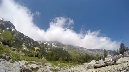 quad hd : Time lapse of clouds roiling and flowing over peak Vihren on Pirin Mountain. A famous climbing, hiking place, reaching 2,914 metres, it is Bulgarias second and the Balkans third highest peak. UHD 4K stock footage Stock Footage