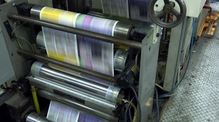 printings : Web set offset print shop newspapers Printing, Newspapers coming off the rotation printing press industrial machine. UHD steadycam 4K stock footage