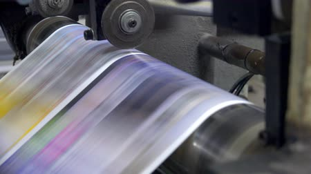 print shop : Web set offset print shop newspapers Printing, Newspapers coming off the rotation printing press industrial machine. UHD steadycam 4K stock footage