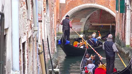 karnaval : 4K tourists enjoy gondola ride at narrow canel. Gondola is Venice world famous attraction. UHD stock video
