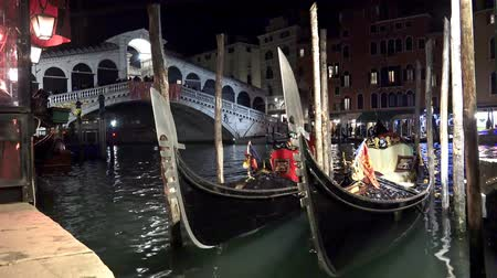 quad hd : 4K night view of gondola near Rialto bridge. UHD stock video Stock Footage
