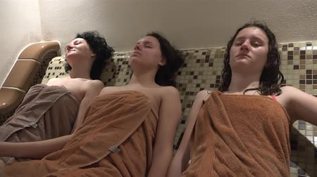 tři lidé : Three family female enjoy spa sauna steam bath. UHD steadycam 4K stock footage