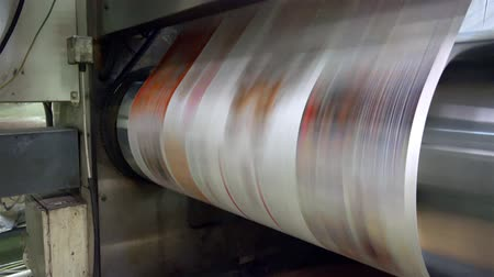 basın : Web set offset print shop newspapers Printint, Newspapers coming off the rotation printing press industrial machine. UHD 4K steadycam stock footage Stok Video