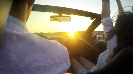 Couple driving convertible car cabriolet with hands up. UHD 4K stock footage