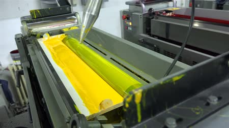 print shop : Print machine ink rollers with basic colors. UHD 4K steadycam shot