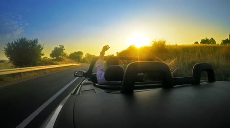 drive : Cabriolet convertable car drive with summer sunset shine at background. UHD 4K stock footage