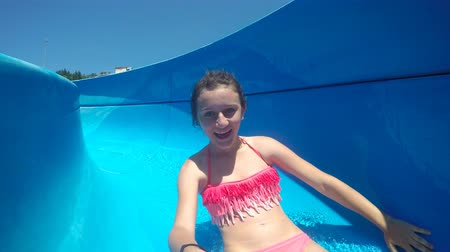 slayt : Girl ride on Water slide at Aqua Park