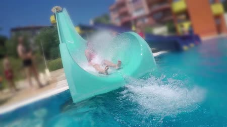 slayt : Girl on Water slide at Aqua Park SLOW MOTION Stok Video
