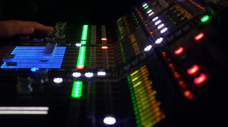 kayıt : 4k audio recording professional adjusts large mixing board in recording studio Stok Video