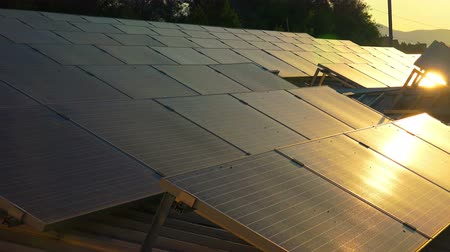 e : solar panels roof at sunset, photovoltaic green energy generator