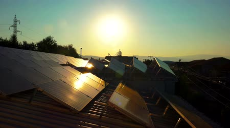 çatı : solar panels roof at sunset, photovoltaic green energy generator