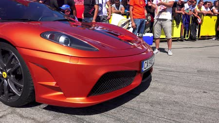 tuned : Ferrari car on start line at Kondofrey drag race track Stock Footage