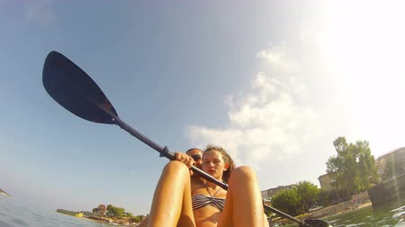 kayak : Father teaches daughter kayaking in tropical waters, Stock Footage
