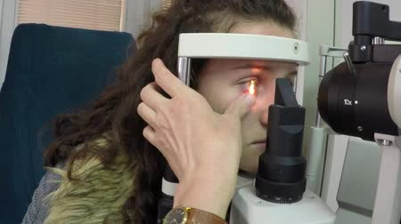 astigmatism : Eye Doctor, a test with young patient in his office